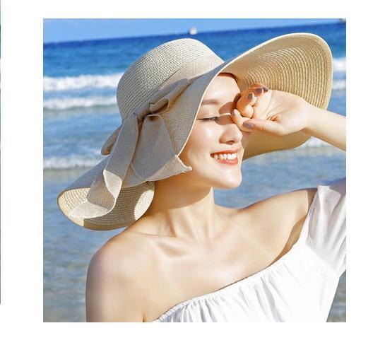 Hình ảnh Mũ đi biển rộng vành màu kem trắng buộc nơ nữ tính