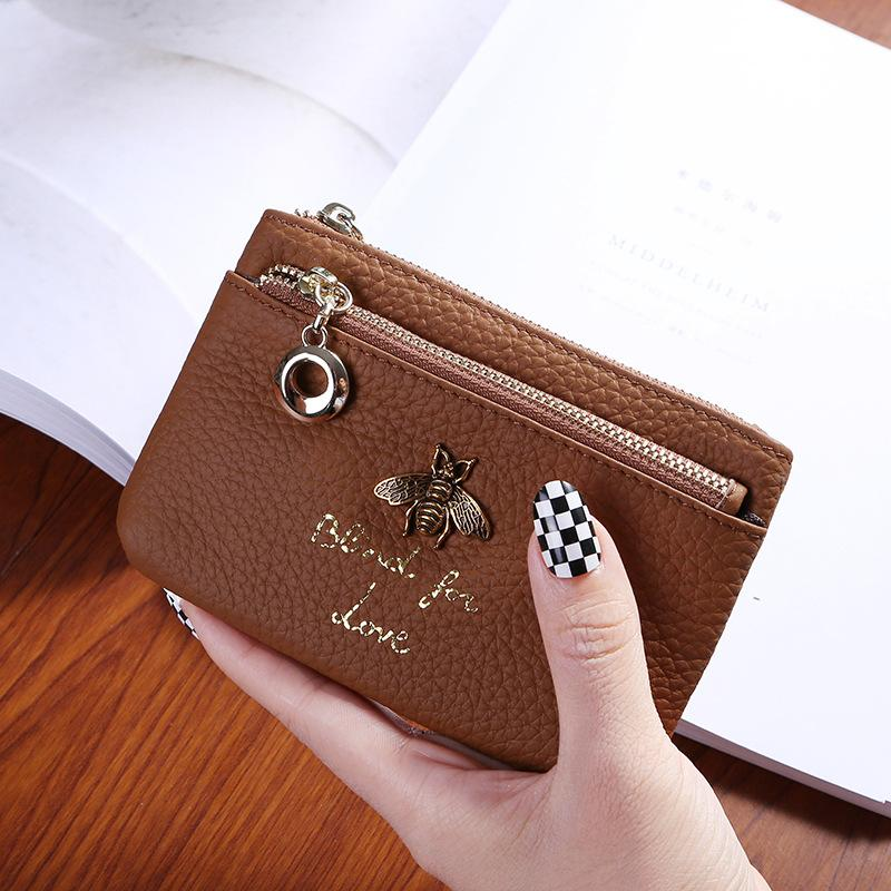 หนังวัวชั้นต้นหญิงกระเป๋าสตางค์แบบพับ 2017 เสื้อผ้าแฟชั่น ใหม่ผู้หญิงกระเป๋าผึ้งกระเป๋าสตางค์สุภาพสตรีแบบสั้นกระเป๋าหนังถือ By Taobao Collection.