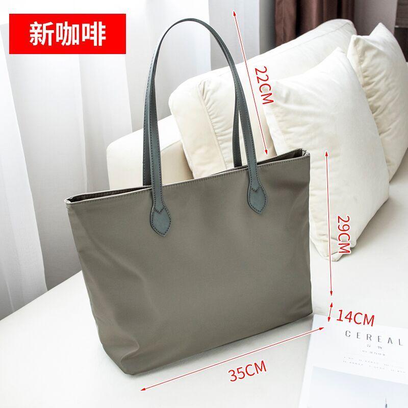 กระเป๋าถือ นักเรียน ผู้หญิง วัยรุ่น กระบี่ 2019 Xinjianyue กระเป๋าผ้าใบ Tote Bag กระเป๋าผ้าไนลอนกระเป๋าถือหญิงความจุขนาดใหญ่กระเป๋ากระเป๋าสะพายไหล่หญิงกระเป๋าสะพายขนาดใหญ่