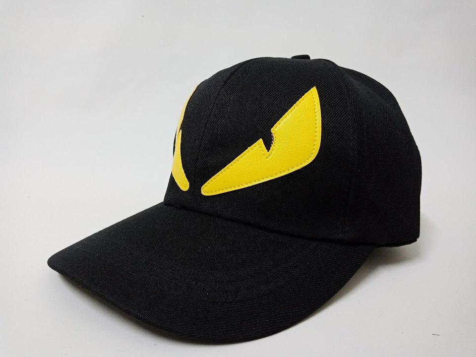 Hình ảnh Mũ ( nón ) Lưỡi trai Mắt Vàng ( đen )