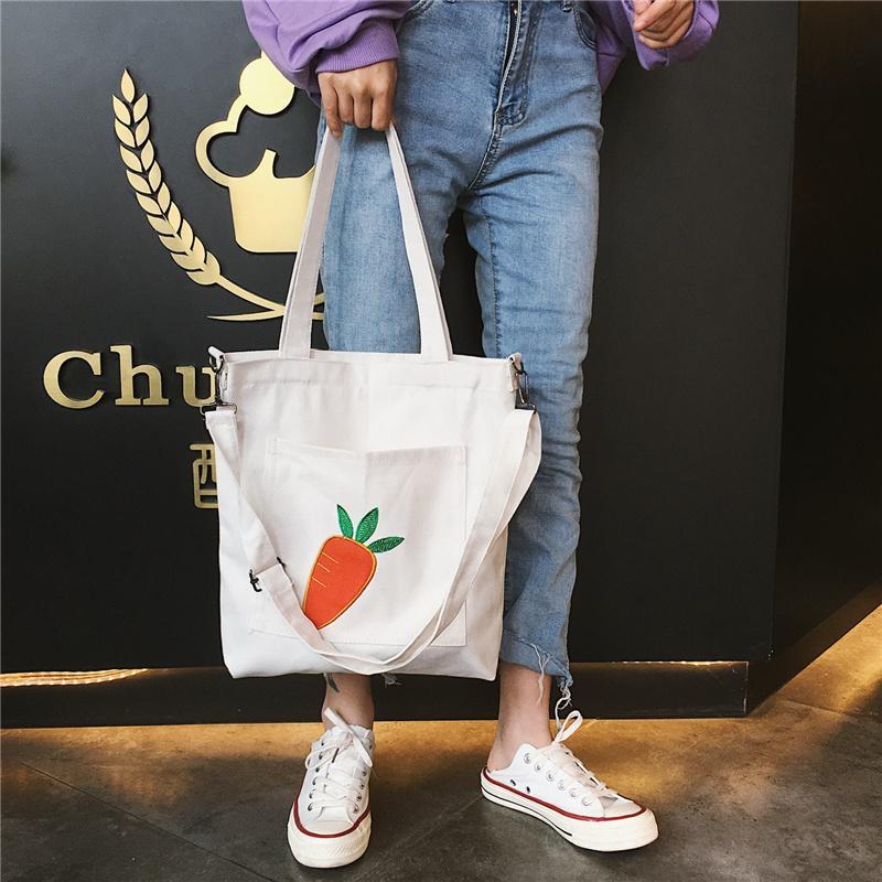ระนอง ไหล่ทั้งสองข้างอเนกประสงค์ 2019 ใหม่กระเป๋าผ้าใบหญิงสไตล์เกาหลีเรียบง่ายเข้ากับทุกรูปแบบความจุขนาดใหญ่ INS เสื้อผ้าแฟชั่น ในแพคเกจนักศึกษาถุงหิ้ว